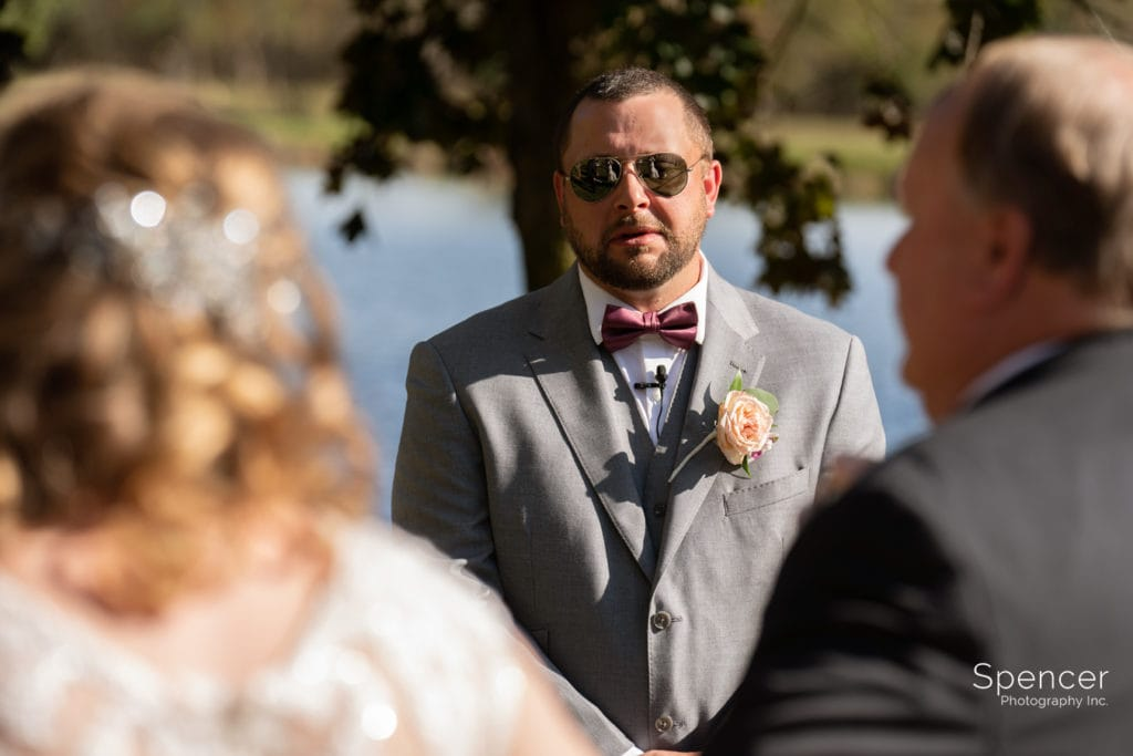 groom reacting to bride at wedding ceremony