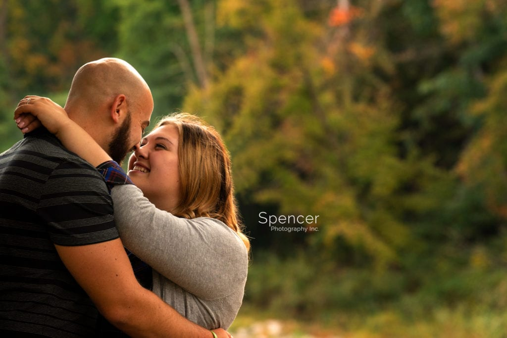 couple kissing during their engagement session in Mill Stream Park