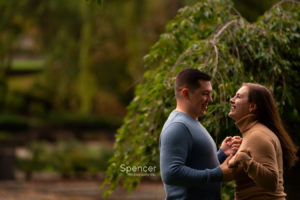 happy engagement photo in wade oval park
