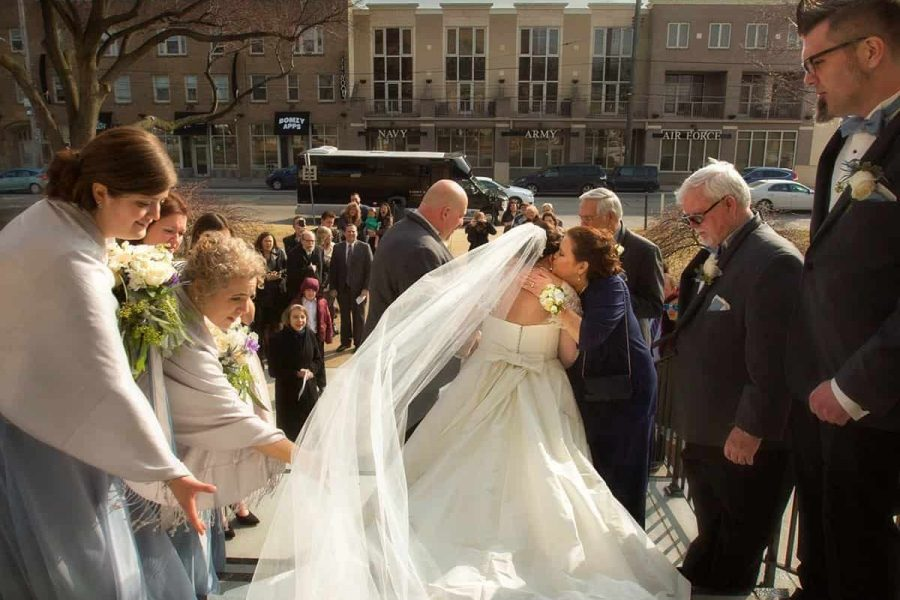 candid picture of couple leaving wedding ceremony at Lakewood United Methodist Church